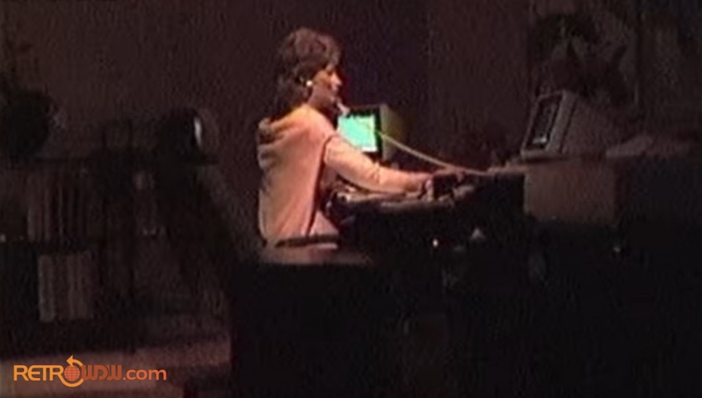 Vintage Spaceship Earth scene of woman working at a computer in her office