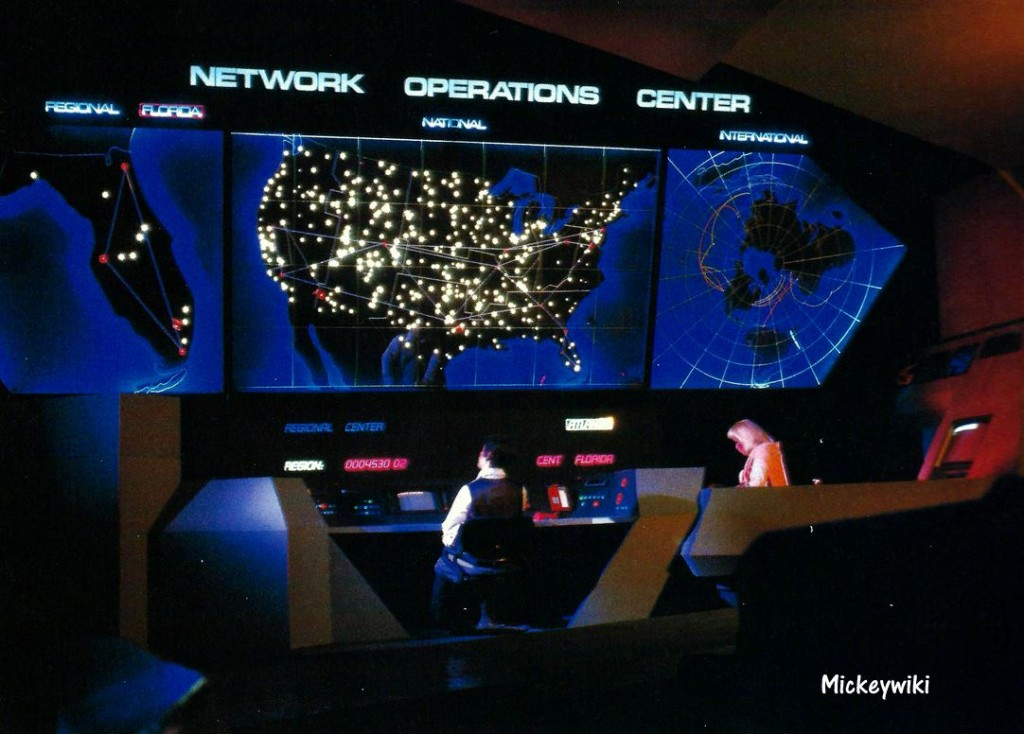 Vintage Spaceship Earth Scene featuring two animatronics at a Network Operations Center with a large digital map on a wall and control panels at a desk